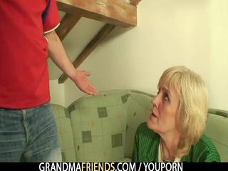 Two football fans bang granny