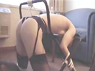 me tied to a clothes rack and getting spanked by