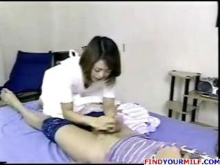 Japanese mom wakes up and rubs her pussy before
