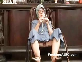 Horny granny fingers herself and gives soaking
