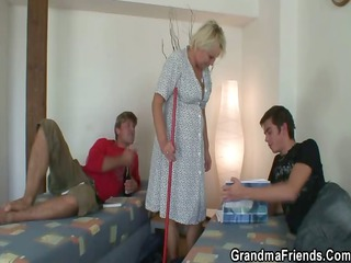 Old cleaning woman is banged by two lads