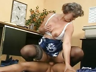 Mature shows her tits and hairy pussy
