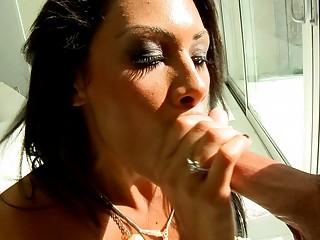 Classy brunette MILF gives fantastic blowjob