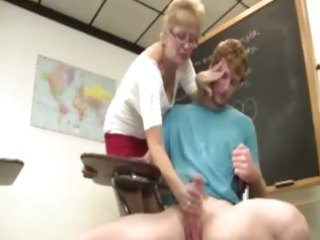 Granny teacher tugs her students cock in the