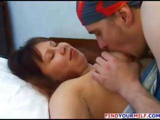 Chubby, busty brunette Russian MILF Elena eats