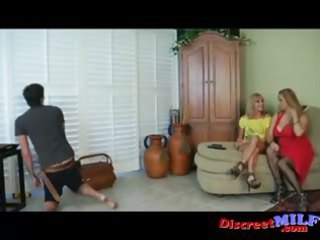 Two MILFs give cable guy handjob