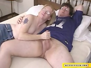 Mature blonde sucking on a small cock