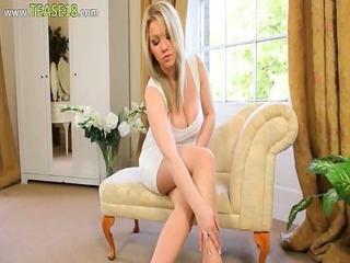 pleasing blonde bride teasing on sofa