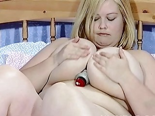 Big breasted blonde MILF hoe toys her hungry