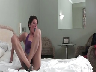 Brunette slim mature fucks vibrator upskirt in bed