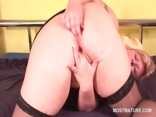 Fat blonde mature pleasuring her pink tasty pussy