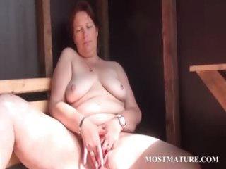 Outdoor cunt masturbation with mature
