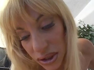 Sexy youthful chick plays with her clitoris as