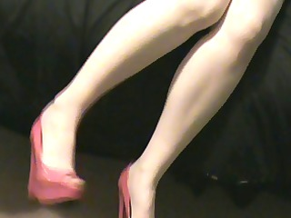 wife in a pink corset pink stockings and high