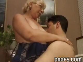 Mature granny gets a younger cock to suck and get
