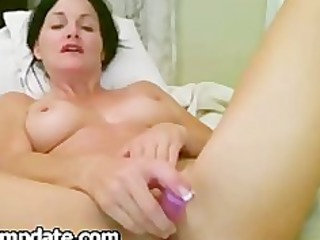 Beautiful MILF toying her horny snatch