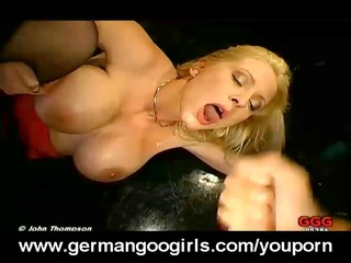 Busty MILF swallowing semen