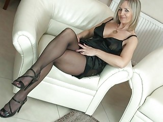 Sexy blonde milf in pantyhose uncovers her ass on