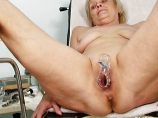 Dirty blonde granny gets her pussy gaped at gyno