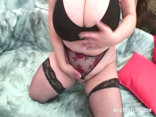 Busty BBW mature rubbing her fat cunt in close-up