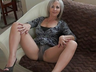 Handsome blonde momma in pantyhose does
