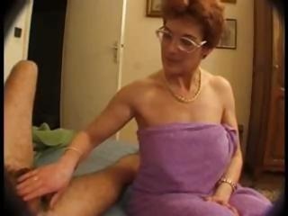 Hairy mature in glasses takes on two cocks and