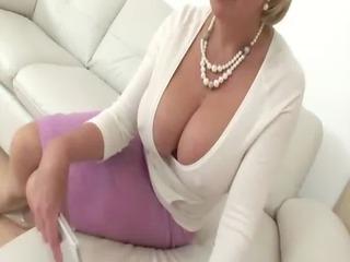 Mature blonde in glasses shows big tits