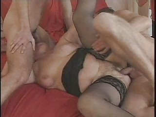 Mature in Glasses and Stockings Plays with 2 Cocks