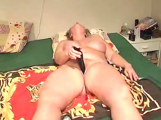 Mature lady masturbates with toy while husband