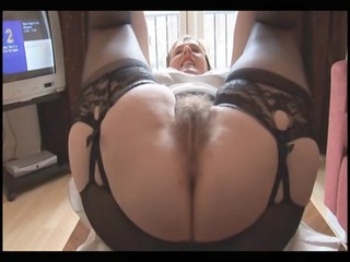 Hairy busty mature lady in slip and girdle does