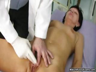 Old doctor inspecting a hairy mature mom part2